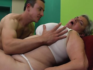Dirty granny with a big belly boning the horny guy