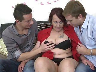 Naughty mature lady sucking and fucking two guys at once